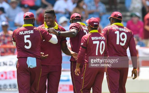 Oshane Thomas of West Indies celebrates the dismissal of Tom Curran of England during the 5th and final ODI between West Indies and England at Darren...