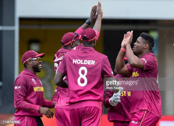 Oshane Thomas of West Indies celebrates with his team mates after taking the wicket of Ross Taylor of New Zealand during the ICC Cricket World Cup...