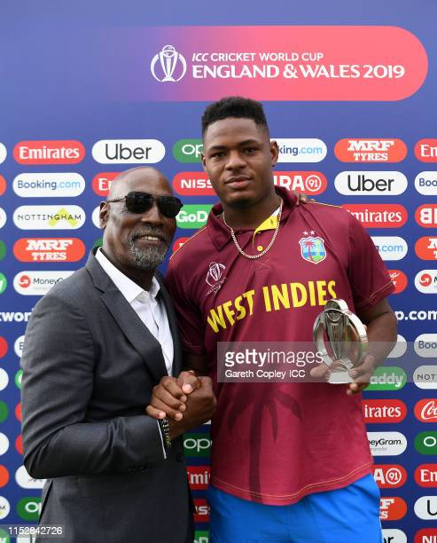 Oshane Thomas of West Indies psoes with the man of the match award with Sir Vivian Richards during the Group Stage match of the ICC Cricket World Cup...