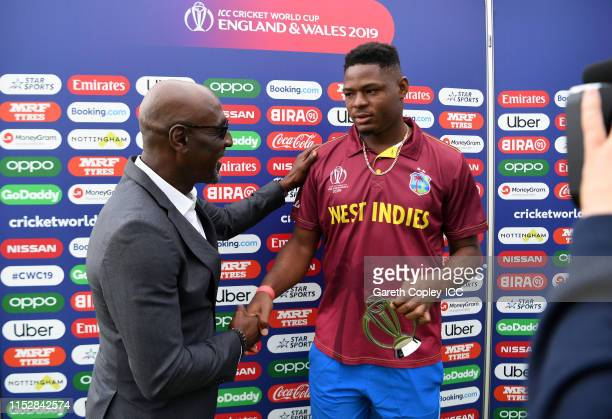 Oshane Thomas of West Indies shakes hands with Sir Vivian Richards during the Group Stage match of the ICC Cricket World Cup 2019 between West Indies...