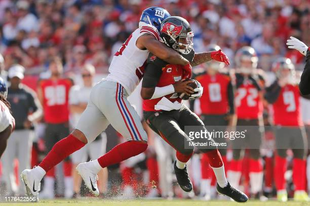 Oshane Ximines of the New York Giants sacks Jameis Winston of the Tampa Bay Buccaneers during the second quarter at Raymond James Stadium on...