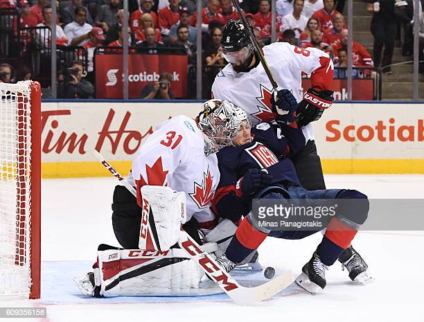 J Oshie of Team USA collides with Carey Price and Drew Doughty of Team Canada during the World Cup of Hockey 2016 at Air Canada Centre on September...