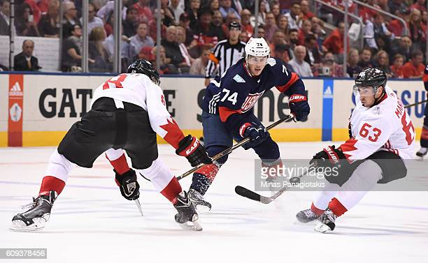 J Oshie of Team USA flips the puck past Drew Doughty and Brad Marchand of Team Canada during the World Cup of Hockey 2016 at Air Canada Centre on...