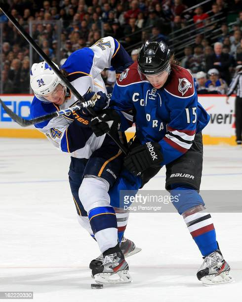 Oshie of the St. Louis Blues and P.A. Parenteau of the Colorado Avalanche battle for control of the puck in the first period at the Pepsi Center on...