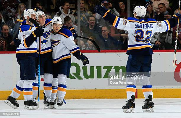J Oshie of the St Louis Blues celebrates his game winning goal in overtime against the Colorado Avalanche with teammates Barret Jackman Jaden...