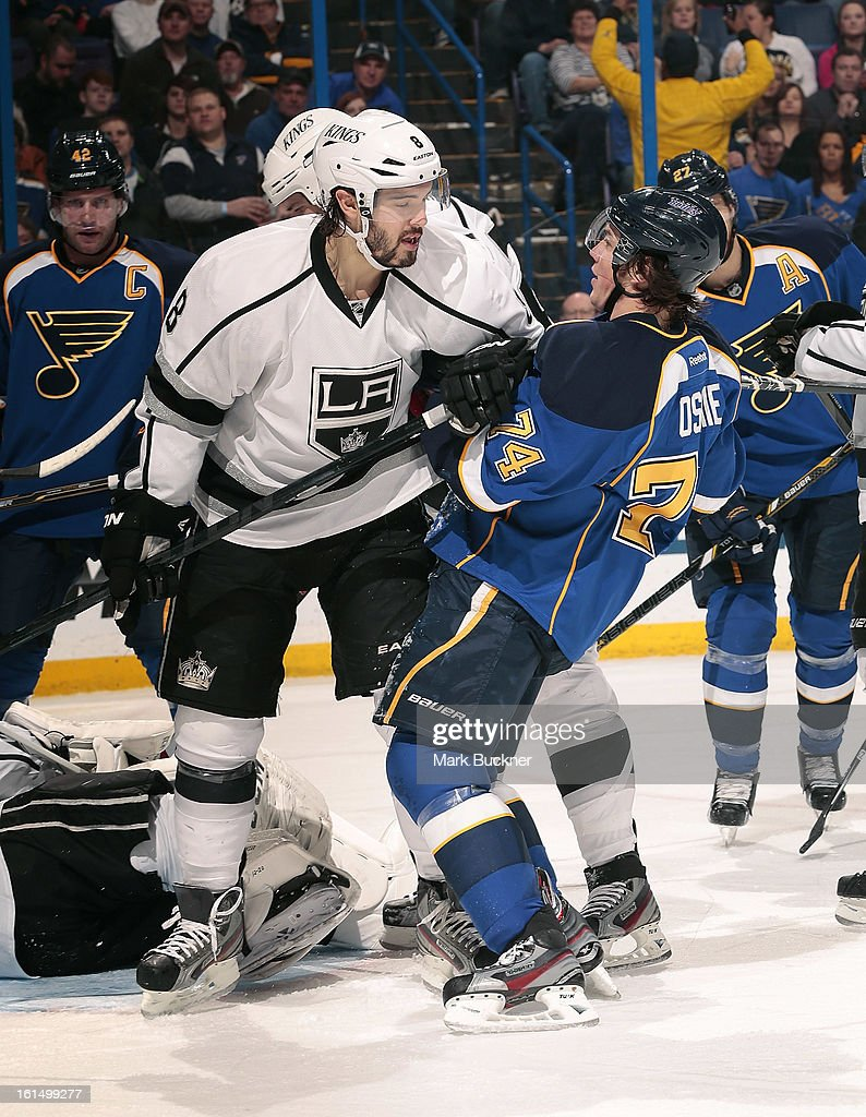 T.J. Oshie #74 of the St. Louis Blues collides with Drew Doughty #8 of the Anaheim Ducks in an NHL game on February 11, 2013 at Scottrade Center in St. Louis, Missouri.