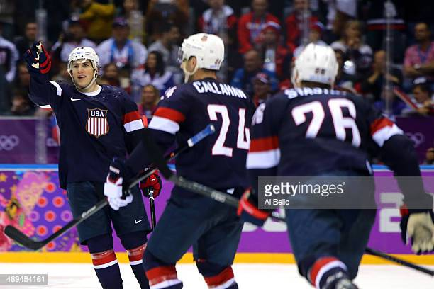 J Oshie of the United States celebrates with teammates Ryan Callahan and Paul Stastny after scoring on a shootout against Sergei Bobrovski of Russia...