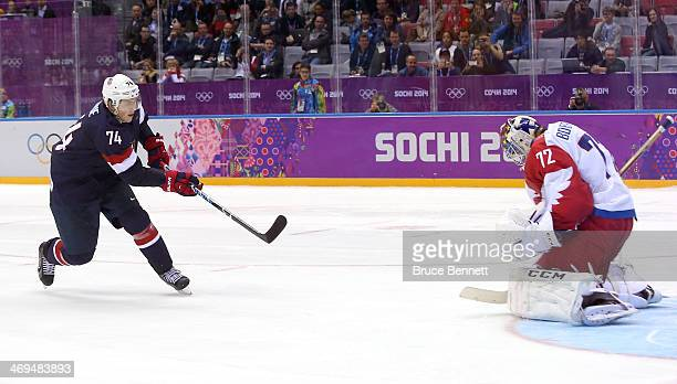 J Oshie of the United States scores on a shootout against Sergei Bobrovski of Russia to win the Men's Ice Hockey Preliminary Round Group A game on...