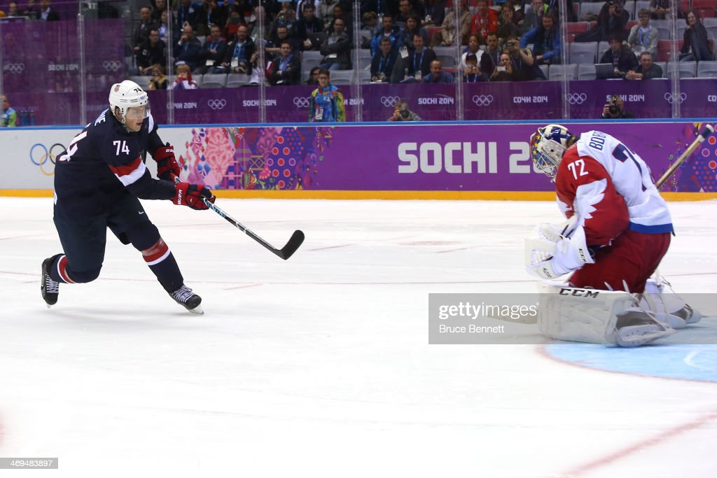 T.J. Oshie #74 of the United States scores on a shootout against Sergei Bobrovski #72 of Russia to win the Men's Ice Hockey Preliminary Round Group A game on day eight of the Sochi 2014 Winter Olympics at Bolshoy Ice Dome on February 15, 2014 in Sochi, Russia.
