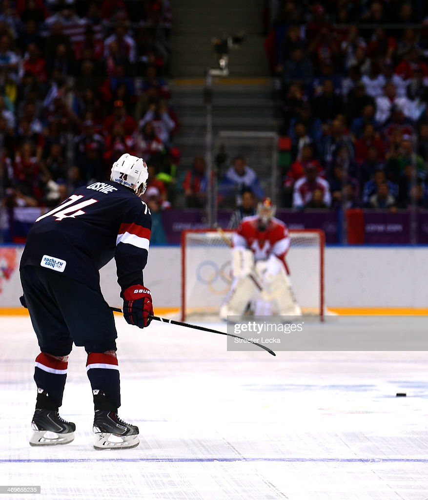 T.J. Oshie #74 of the United States scores on a shootout against Sergei Bobrovski #72 of Russia during the Men's Ice Hockey Preliminary Round Group A game on day eight of the Sochi 2014 Winter Olympics at Bolshoy Ice Dome on February 15, 2014 in Sochi, Russia.