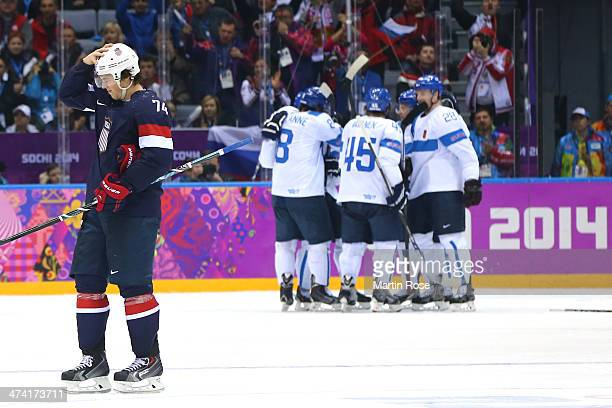 J Oshie of the United States skates as Finland celebrate a goal in the third period during the Men's Ice Hockey Bronze Medal Game on Day 15 of the...