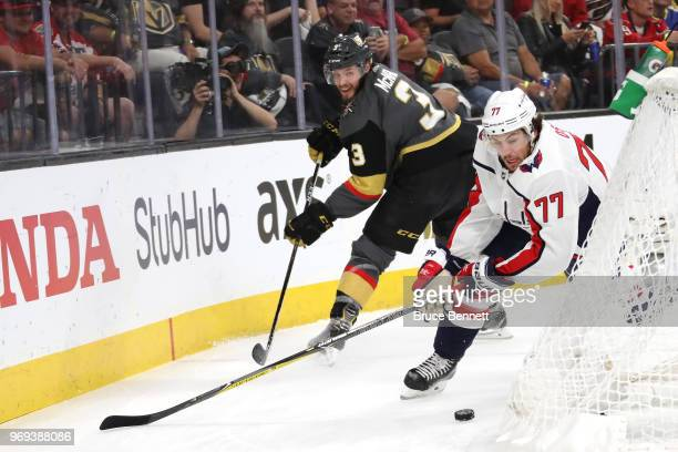 J Oshie of the Washington Capitals and Brayden McNabb of the Vegas Golden Knights battle for the puck during the first period in Game Five of the...