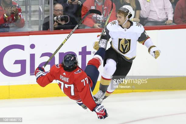 J Oshie of the Washington Capitals and Jon Merrill of the Vegas Golden Knights collide during the second period at Capital One Arena on October 10...