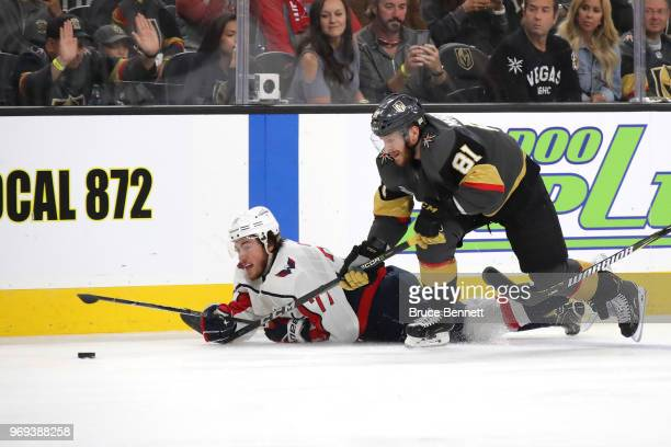 J Oshie of the Washington Capitals and Jonathan Marchessault of the Vegas Golden Knights battle for the puck during the first period in Game Five of...