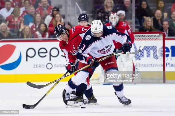 J Oshie of the Washington Capitals and Seth Jones of the Columbus Blue Jackets battle for the puck in the third period at Capital One Arena on...