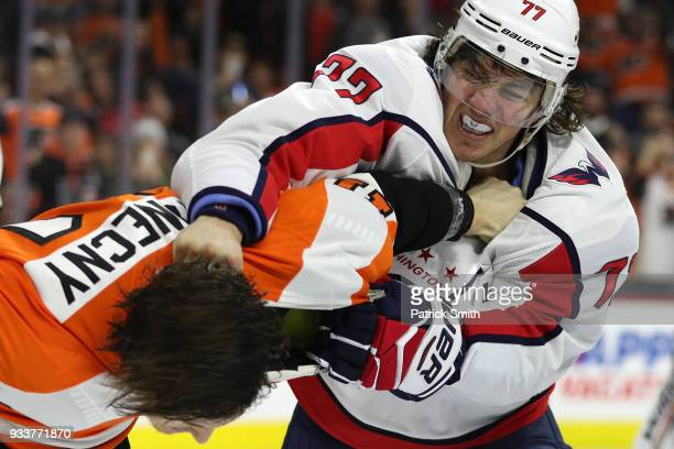 Oshie of the Washington Capitals and Travis Konecny of the Philadelphia Flyers fight during the third period at Wells Fargo Center on March 18, 2018...