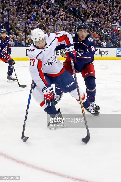 J Oshie of the Washington Capitals and Zach Werenski of the Columbus Blue Jackets battle for control of the puck in Game Four of the Eastern...