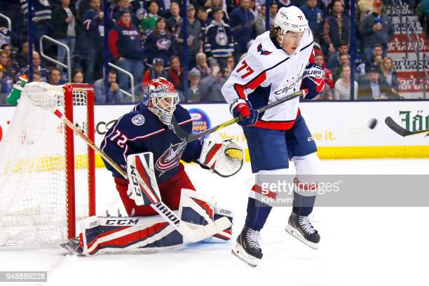 J Oshie of the Washington Capitals attempts to screen goalie Sergei Bobrovsky of the Columbus Blue Jackets from a shot during the third period in...