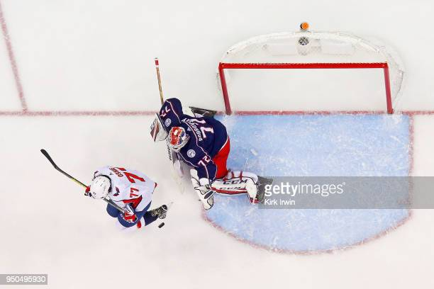 J Oshie of the Washington Capitals attempts to screen Sergei Bobrovsky of the Columbus Blue Jackets from a shot in Game Four of the Eastern...
