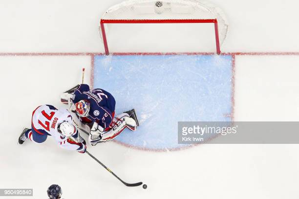 J Oshie of the Washington Capitals attempts to shoot the puck past Sergei Bobrovsky of the Columbus Blue Jackets in Game Four of the Eastern...