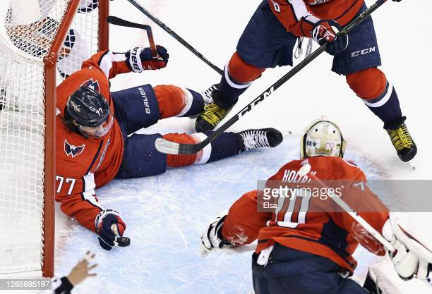 Oshie of the Washington Capitals bats the puck away from the net during the second period against the New York Islanders in Game One of the Eastern...
