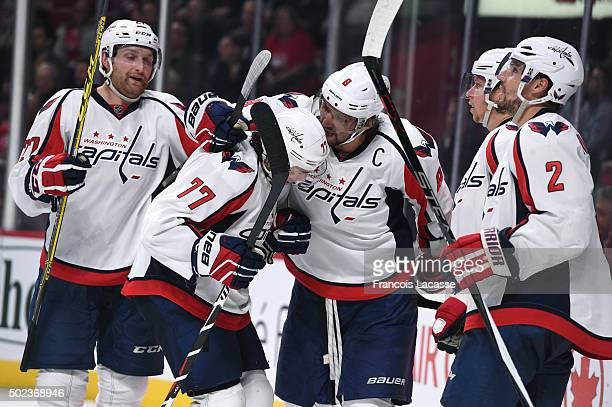 J Oshie of the Washington Capitals celebrates after scoring a goal against the Montreal Canadiens in the NHL game at the Bell Centre on December 3...