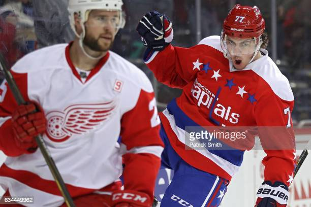 J Oshie of the Washington Capitals celebrates his goal in front of Mike Green of the Detroit Red Wings during the second period at Verizon Center on...