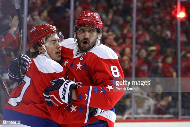 J Oshie of the Washington Capitals celebrates his goal with teammate Alex Ovechkin against the Detroit Red Wings during the second period at Verizon...
