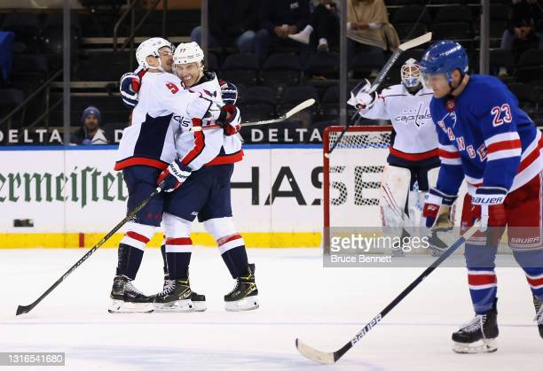 Oshie of the Washington Capitals celebrates his hattrick goal at 18:20 of the third period against the New York Rangers as he is hugged by Dmitry...