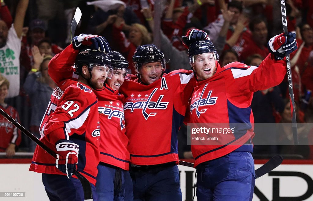 T.J. Oshie #77 of the Washington Capitals celebrates his second period goal against the Tampa Bay Lightning with teammates in Game Six of the Eastern Conference Finals during the 2018 NHL Stanley Cup Playoffs at Capital One Arena on May 21, 2018 in Washington, DC.