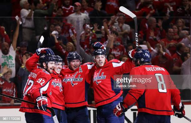 J Oshie of the Washington Capitals celebrates his second period goal against the Tampa Bay Lightning with teammates in Game Six of the Eastern...