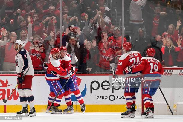 J Oshie of the Washington Capitals celebrates with Alex Ovechkin after scoring the game winning goal in overtime against the Columbus Blue Jackets at...