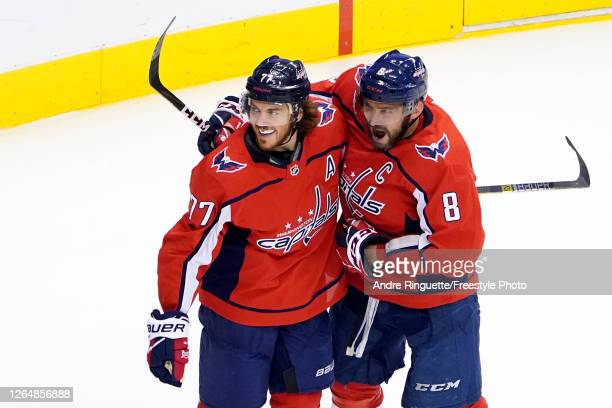 J Oshie of the Washington Capitals celebrates with Alex Ovechkin after scoring a goal on Tuukka Rask of the Boston Bruins during the first period in...