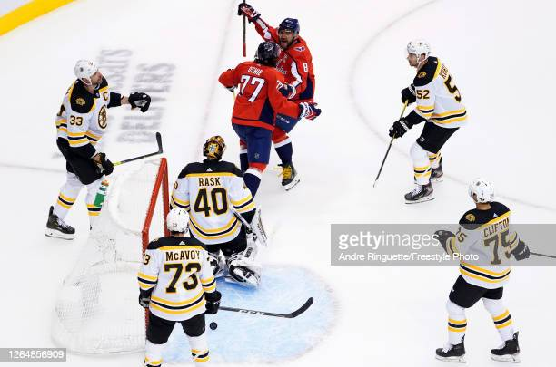 Oshie of the Washington Capitals celebrates with Alex Ovechkin after scoring a goal on Tuukka Rask of the Boston Bruins during the first period in an...