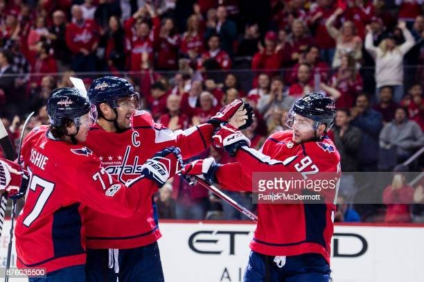 J Oshie of the Washington Capitals celebrates with Alex Ovechkin and Evgeny Kuznetsov after scoring a first period goal against the Minnesota Wild at...