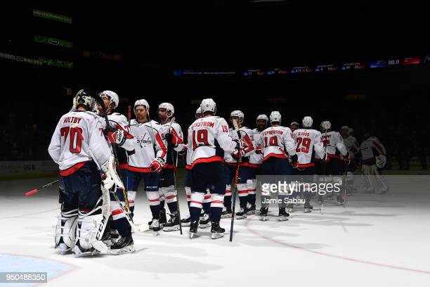 J Oshie of the Washington Capitals celebrates with goaltender Braden Holtby of the Washington Capitals after defeating the Columbus Blue Jackets 63...