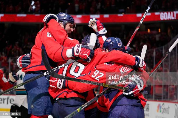 J Oshie of the Washington Capitals celebrates with his teammates after scoring a goal in the third period against the San Jose Sharks at Capital One...