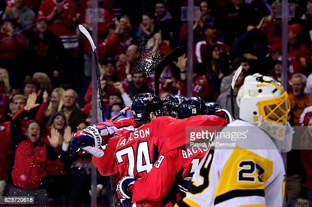 J Oshie of the Washington Capitals celebrates with his teammates after scoring his second goal in the first period during a NHL game against the...