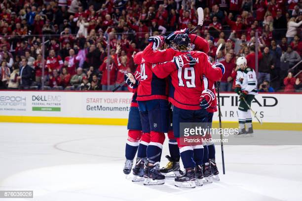 J Oshie of the Washington Capitals celebrates with his teammates after scoring a first period goal against the Minnesota Wild at Capital One Arena on...
