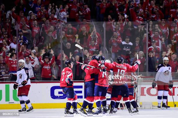 J Oshie of the Washington Capitals celebrates with his teammates after scoring a second period goal against the Columbus Blue Jackets in Game Five of...