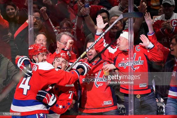 Oshie of the Washington Capitals celebrates with teammate Brenden Dillon after scoring a goal against the Pittsburgh Penguins in the third period at...