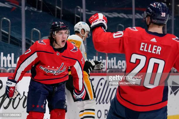 Oshie of the Washington Capitals celebrates with teammate Lars Eller after scoring a goal against the Pittsburgh Penguins in the third period at...