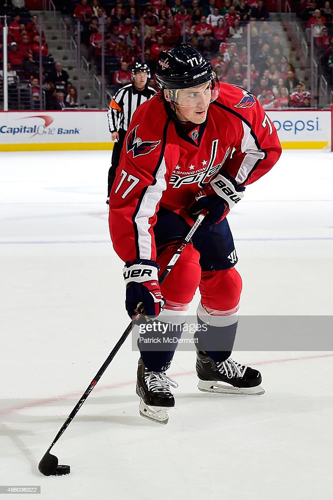 T.J. Oshie #77 of the Washington Capitals controls the puck against the Dallas Stars in the first period during an NHL game at Verizon Center on November 19, 2015 in Washington, DC.
