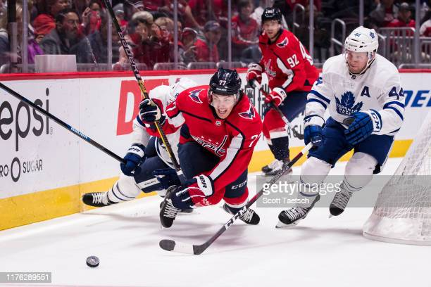 Oshie of the Washington Capitals dives for a loose puck against the Toronto Maple Leafs during the second period at Capital One Arena on October 16,...