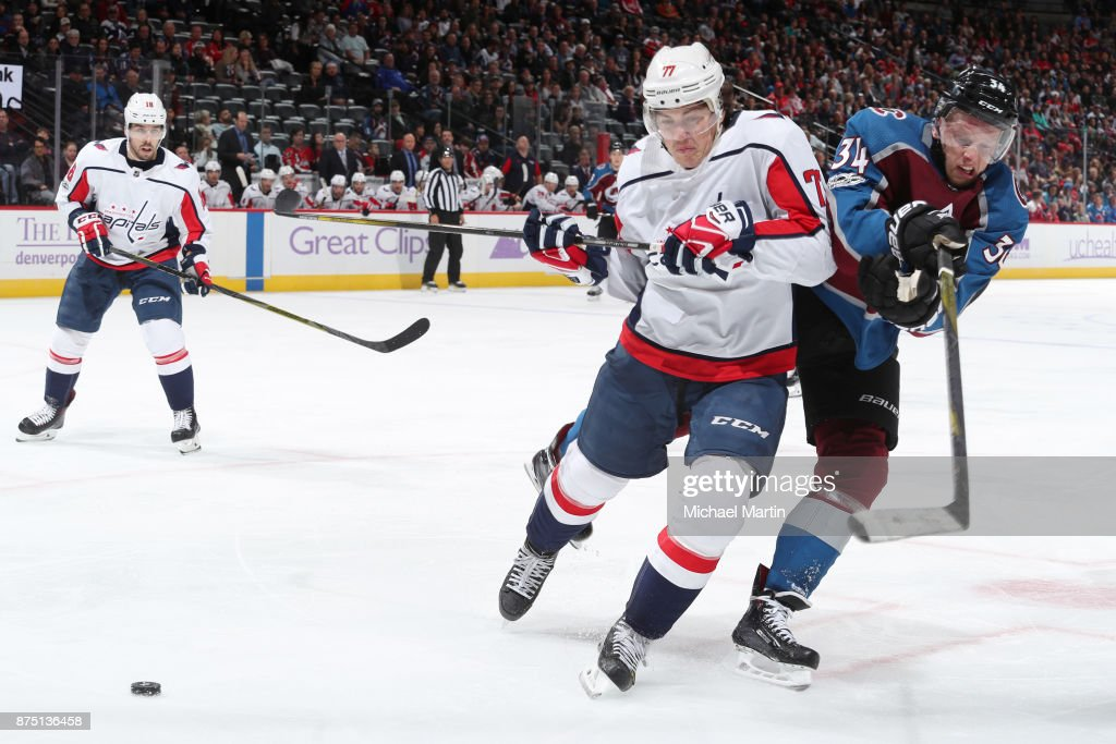 T.J. Oshie #77 of the Washington Capitals fights for position against Carl Soderberg #34 of the Colorado Avalanche at the Pepsi Center on November 16, 2017 in Denver, Colorado.