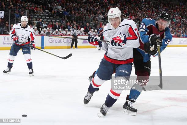 J Oshie of the Washington Capitals fights for position against Carl Soderberg of the Colorado Avalanche at the Pepsi Center on November 16 2017 in...