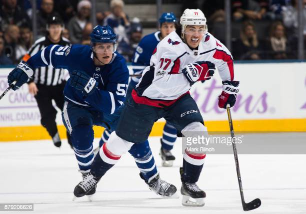 J Oshie of the Washington Capitals is chased by Jake Gardiner of the Toronto Maple Leafs during the second period at the Air Canada Centre on...