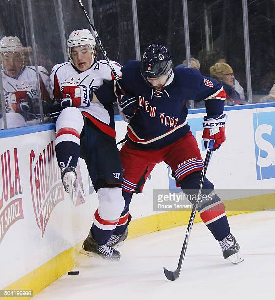 J Oshie of the Washington Capitals is checked by Kevin Klein of the New York Rangers at Madison Square Garden on January 9 2016 in New York City The...