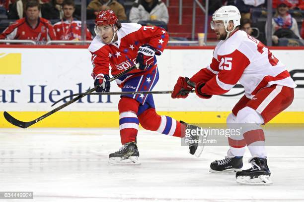 J Oshie of the Washington Capitals scores a goal in front of Mike Green of the Detroit Red Wings during the second period at Verizon Center on...