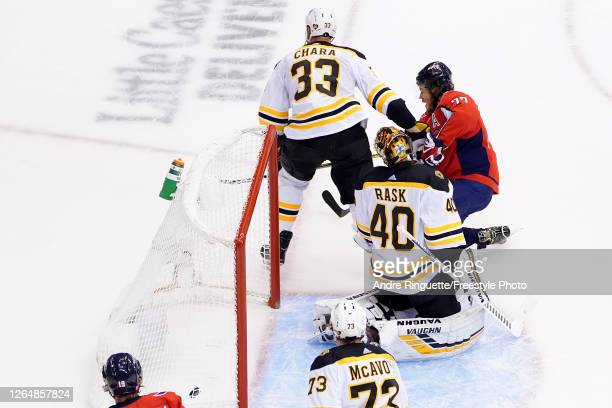 Oshie of the Washington Capitals scores a goal on Tuukka Rask of the Boston Bruins during the first period in an Eastern Conference Round Robin game...